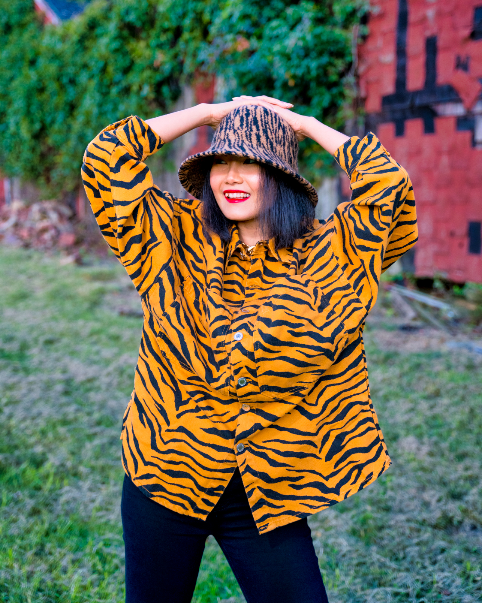 nanphanita jacob that hat girl is wearing head to toe with animal pattern tiger print bucket hat by san diego hat company knh2023
